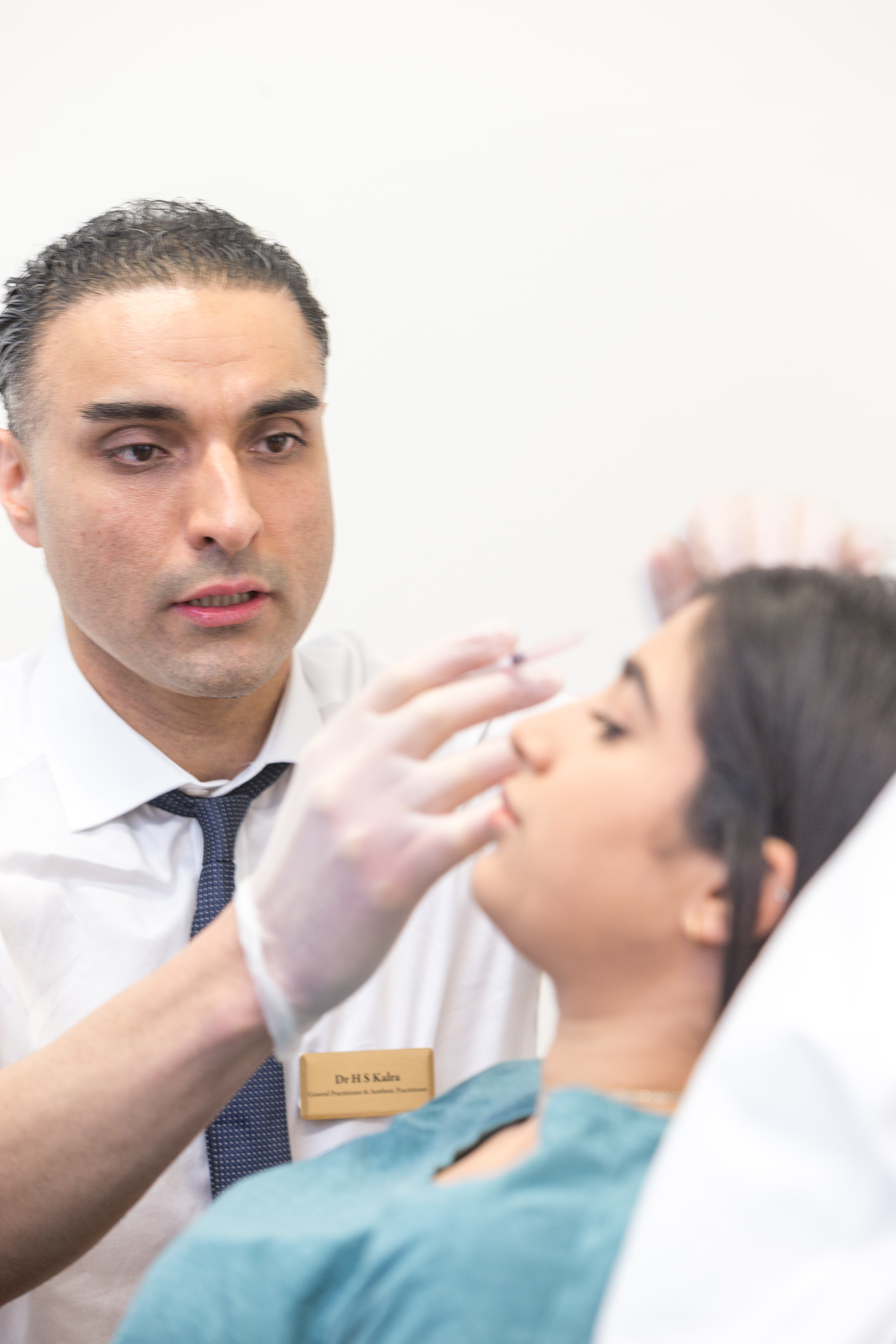 Dr Karla treating a patient with botox injection